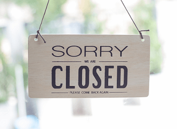 Sign on door of business that reads Sorry We Are Closed Please Come Back Again